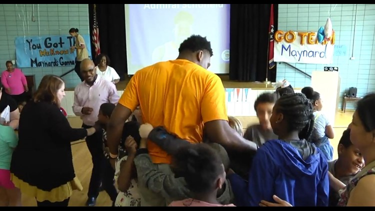 Admiral Schofield surrounded by school k ids