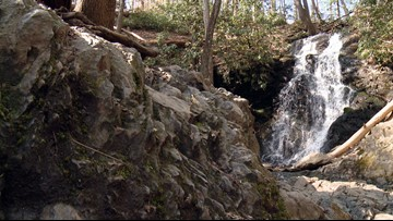 Hikers relish over rushing waterfalls in the Smokies