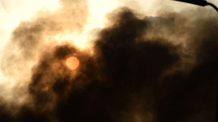 Trash fire blocks sun