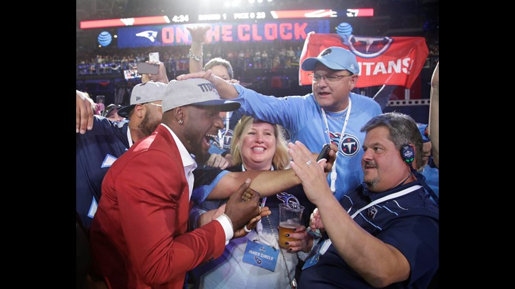 Arlington, TX, USA; Rashaan Evans (Alabama) celebrates with fans after being selected as the number twenty-two overall pick to the Tennessee Titans in the first round of the 2018 NFL Draft at AT&T Stadium. Credit: Tim Heitman-USA TODAY Sports