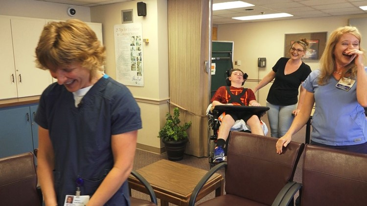 12-year-old stroke victim Jonathan Cummings makes his mother and therapists laugh at Fort Sanders Regional Medical Center in Knoxville.