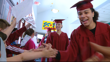 Senior Stroll: Fulton HS grads pay a visit to Christenberry Elementary to inspire students