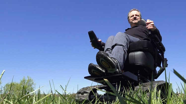 Greg Tipton in his all-terrain electric-powered chair.