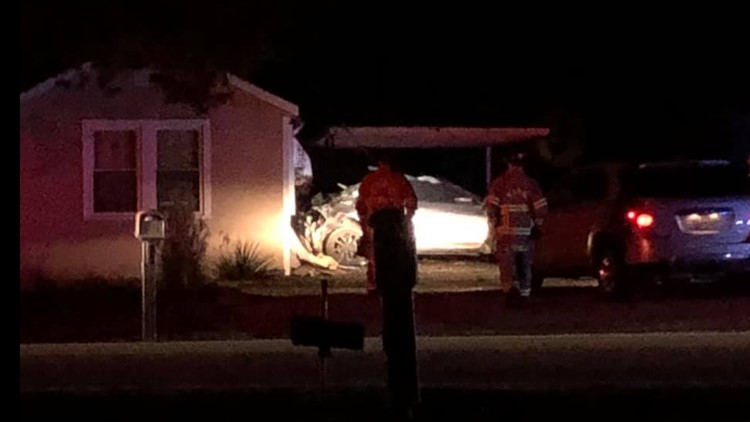 Speeding Nissan slams backwards into Ball Road home.