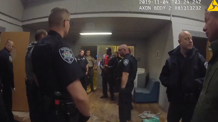Officers gather inside Charlie Unit, amid the disarray.