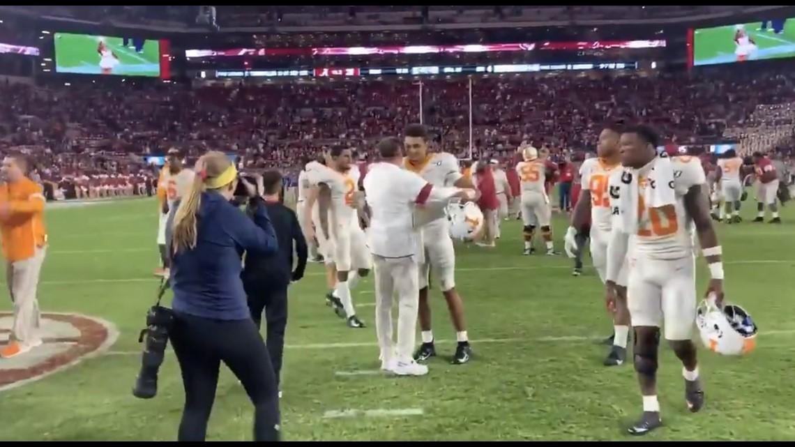Former Vols coach Butch Jones hugs multiple players after Alabama game
