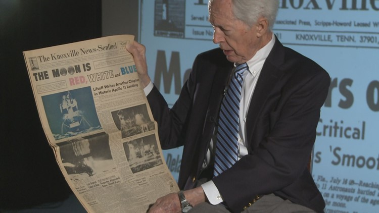 Former KNS city editor Don Ferguson holds an edition of the paper printed after the Apollo 11 moon landing.