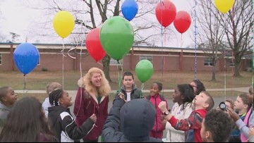Students release balloons with messages to honor Dr. Martin Luther King, Jr.