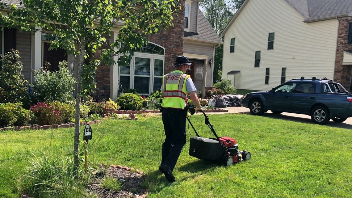 An elderly woman was struggling to mow her lawn. Concord firefighters stepped in to help