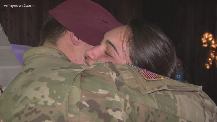soldier surprises wife on her christmas lights stroll