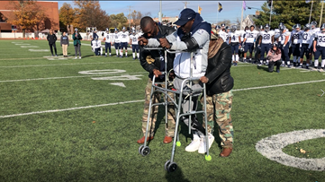 Football player walks again back to the spot where he was critically injured