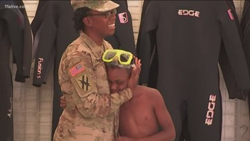Mom deployed to Afghanistan for 9 months surprises son at scuba class