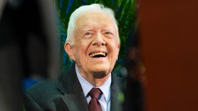 Jimmy Carter is walking, in 'good spirits' following brain surgery