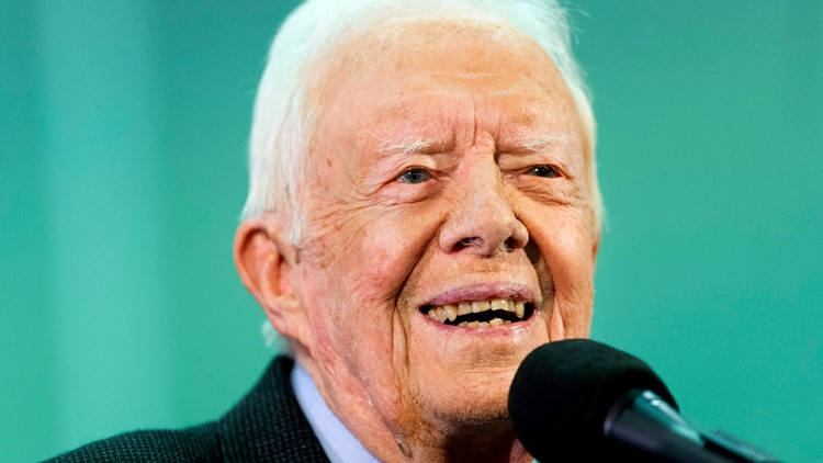 Vaccinated for virus, Former President Jimmy Carter and wife back in church
