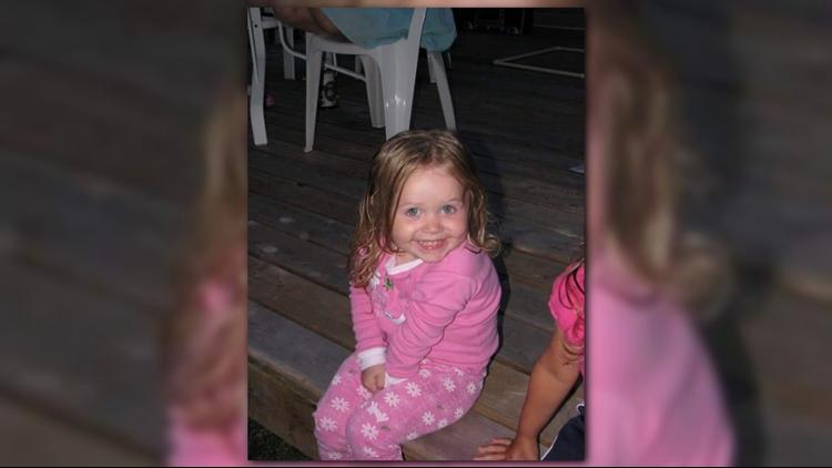 Ella Adams hiding her hand at age 2.